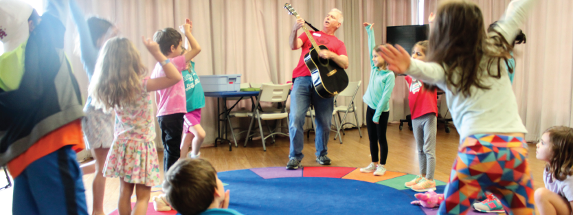 children dance to a musical performance